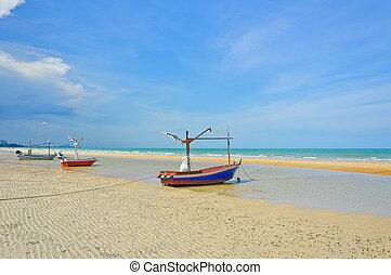 Three fishing boats on beach