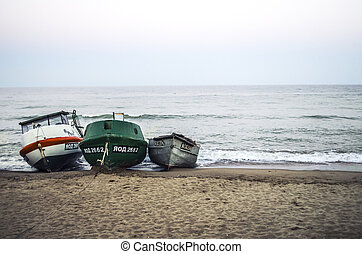 Three fishing boats on the Black Sea.