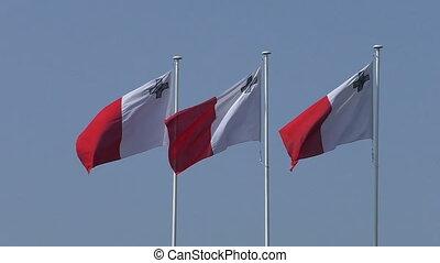 Three flags of Malta waving slowly