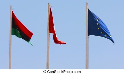 flags of the European Union and Tunisia and Libya - three...