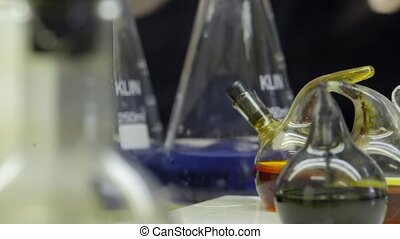 three flask of water black blue solution in science laboratory background