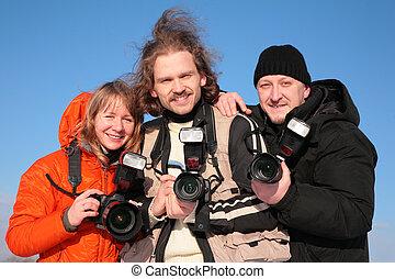 three fotographers against blue sky 2