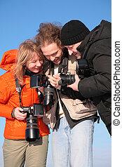 three fotographers against blue sky 3