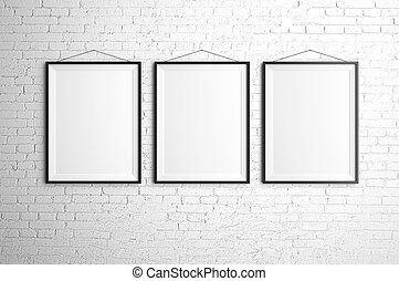 three frames - three black frames on brick wall