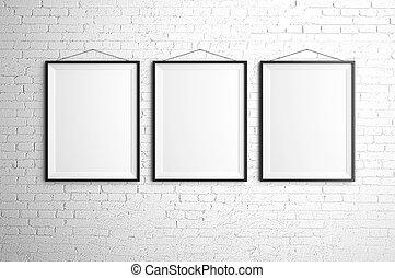 three frames - three black frames on brick wall