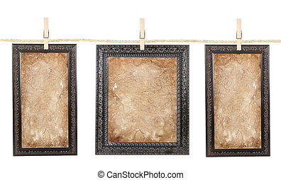 Three frames with aged paper on a line