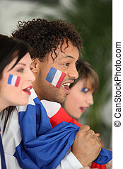 Three French football fans