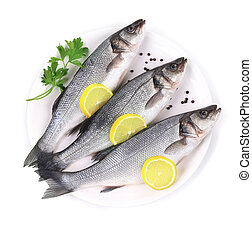 Three fresh seabass with lemon on plate. Isolated on a white...
