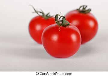 Three fresh tomatoes on white background