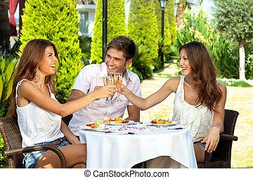 Three friends celebrating