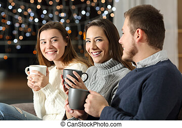 Three friends having a conversation in the night at home