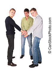 three friends hold hands together