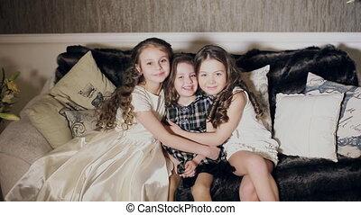 three friends, little girls hugging - three cute friends,...