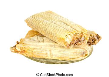 Three Frozen Tamales - Three frozen tamales on plate; ...