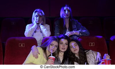 Three frustrated young girls watching an uninteresting movie...