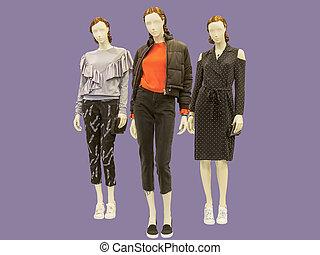 Three full-length female mannequins