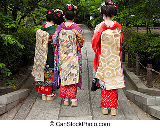 Three geishas - Three geisha wearing kimonos in a ...