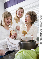 Three generation family at home serving lunch, home-cooked...