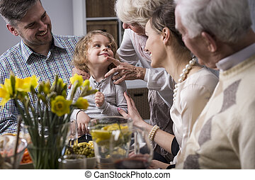 Three-generation family enjoying dinner