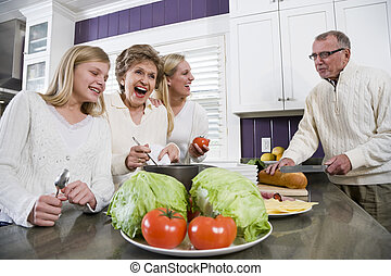 Three generation family in kitchen cooking lunch