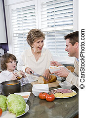 Three generation family in kitchen eating lunch