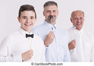 Three generation of man with paper attributes