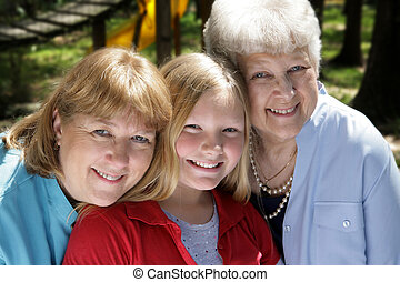 Three Generations in Park - Three generations, a grandmother...