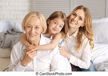 Three generations of females sitting behind each other