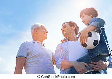 Three generations of men spending time outdoors
