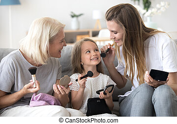 Three generations of women have fun at home together