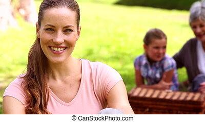 Three generations of women having a picnic