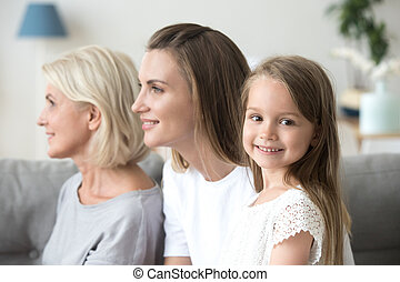 Three generations of women with small girl posing for picture