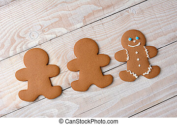 Three Gingerbread Cookies One Decorated