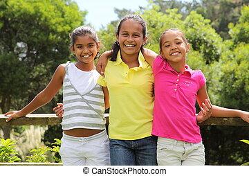 Three girl friends outdoors