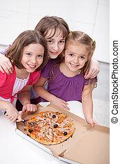 Three girlfriends sharing a pizza