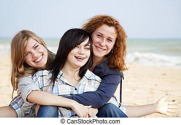 Three girls at outdoor near beach.