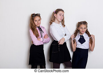 three girls at school boards in the classroom lesson