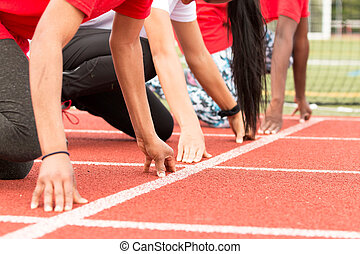 Three girls at the sprint start