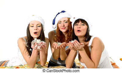 Three girls blow feather on you christmas scene