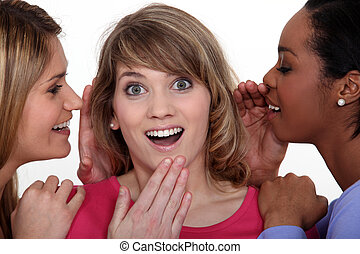 Three girls gossiping