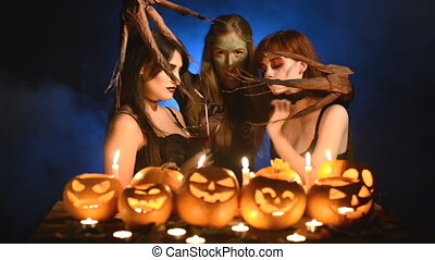 Three girls in Halloween costumes