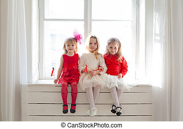 three girls in red and white clothes window