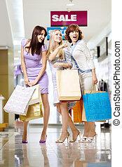 Three girls in shop