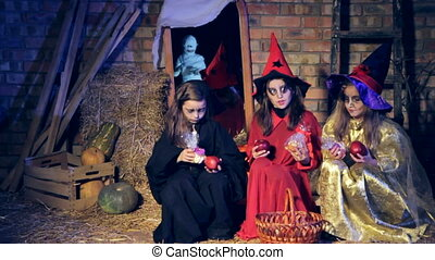 Three girls in witch costumes see a mummy and run away...