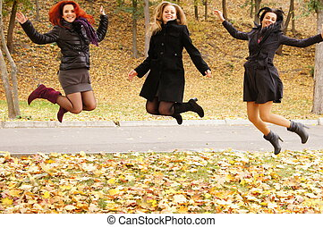 three girls jumping
