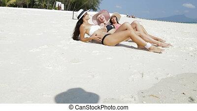 Three Girls Lying On Beach In Bikini And Straw Hats, Enjoy...
