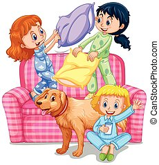 Three girls playing pillow fight at slumber party...
