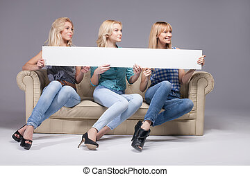 Three girls with empty board.