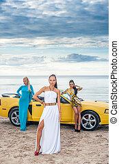 Three girls with sport car