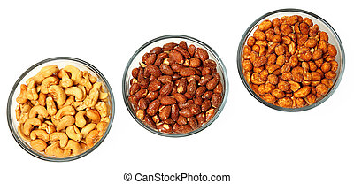 Three glass bowls filled with cashews, salted roasted...